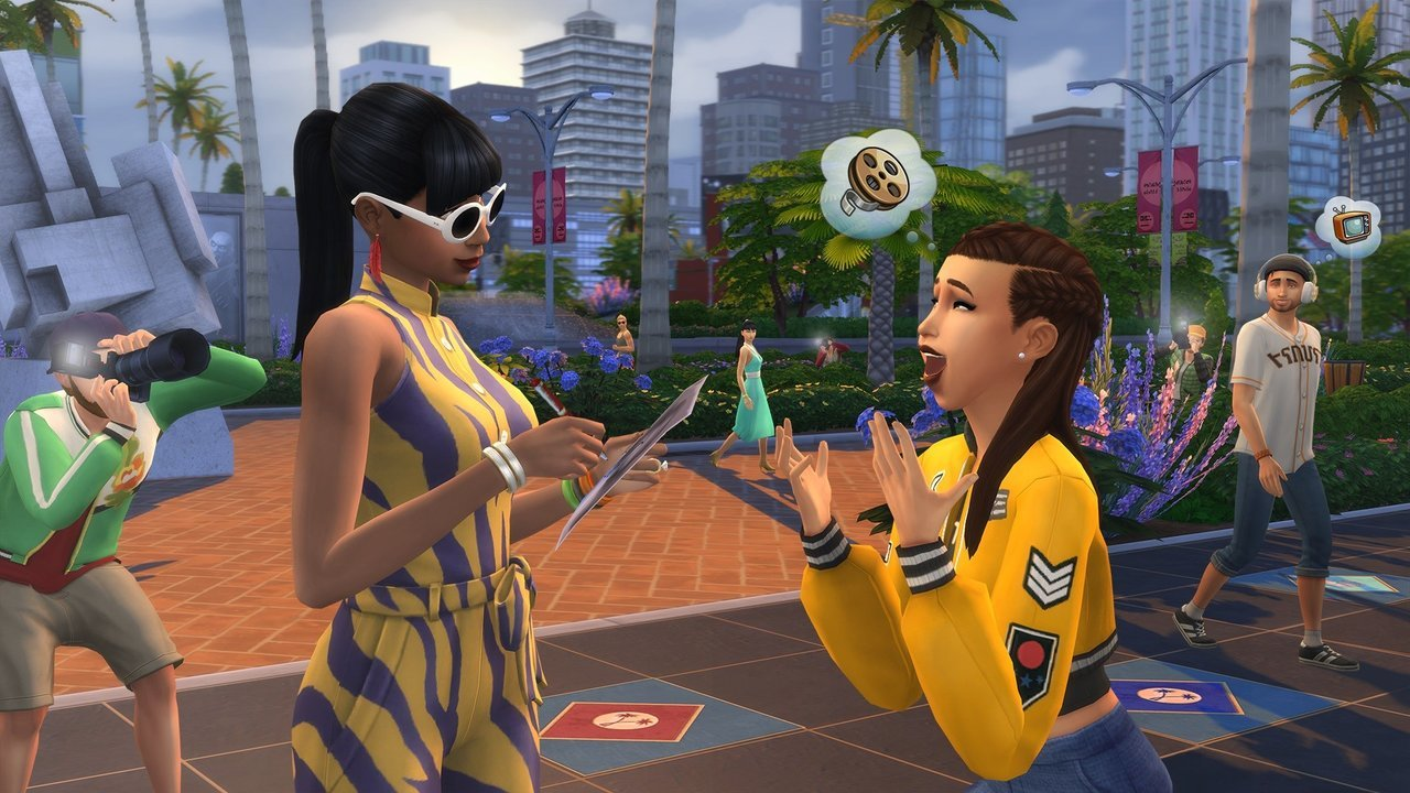 Sims 4 gameplay screenshot - two girls chatting, a man taking a picture